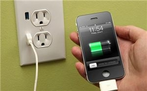 Energy Efficient iPhone Plugged Into Outlet