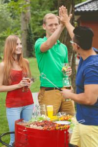 bigstock-Friends-On-A-Barbecue-92792060