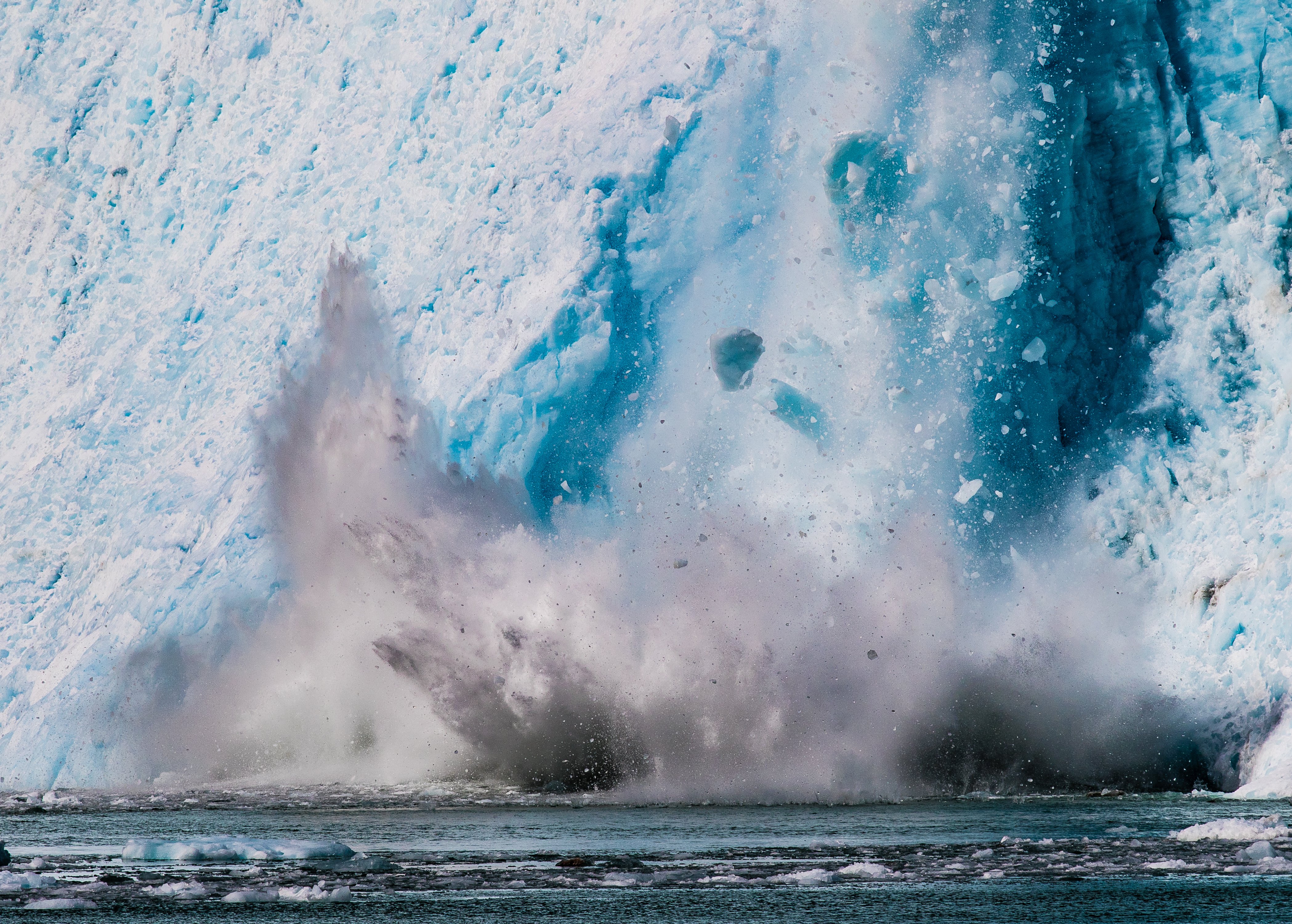 Ice glacier falling into the ocean