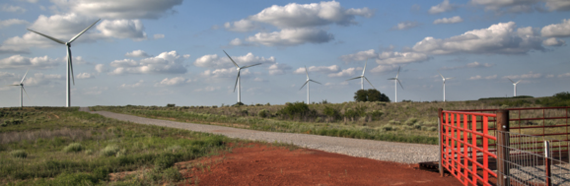 Windmill, road, grass, and dirt